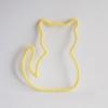 chat tricotin jaune