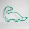 dinosaure tricotin vert