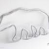 ours polaire en tricotin gris